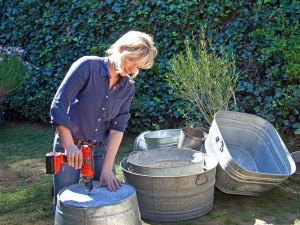 At-Home-Outside_Bohemian-Emily-Henderson-Drilling-Wash-Tub-Planters_s4x3.jpg.rend.hgtvcom.1280.960